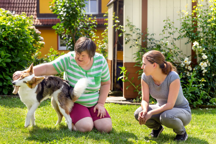 Disabled woman with a second woman and a dog