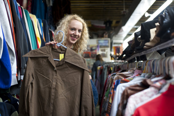 Young woman shopping on thrift store