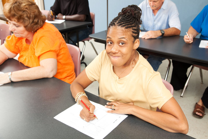Young woman with cerebral palsy in class