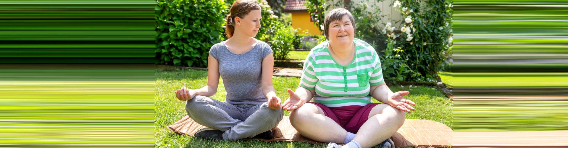 two woman doing yoga